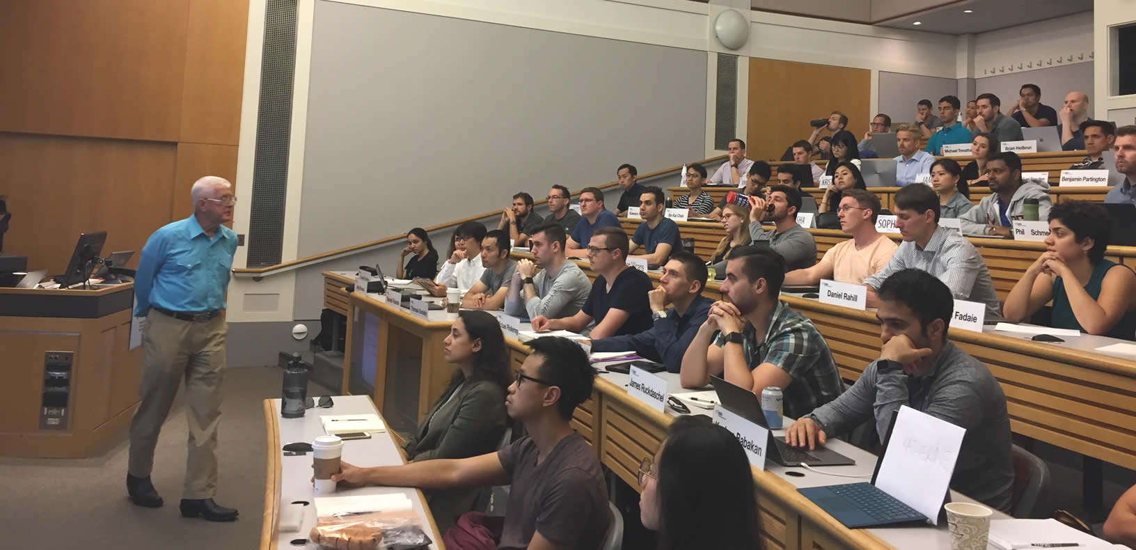 Professor Richard de Neufville standing and talking in front of a full classroom of students